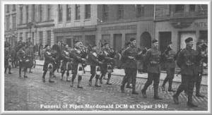 Funeral Pipe Major in streets of Cupar